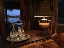 All you need to have when reading a good book, a nice view, a comfortable sofa, good lighting, and a decanter within arms reach.