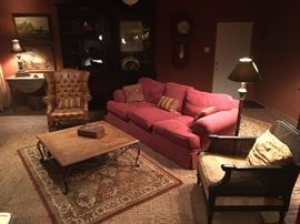 Faux Leather Tuffed Wingback Chair, Herringbone Patterned Wood Top Coffee Table,  Henredon Sofa,  and 1920'a Arm Lounge Chair with Cain sides and back.