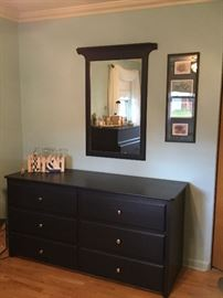 Custom-built bedroom set includes dresser and mirror, chest of drawers, headboard, and two nightstands.