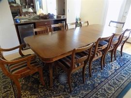 Mahogany dining  table with extra leaves. Very large. 11 chairs. $450