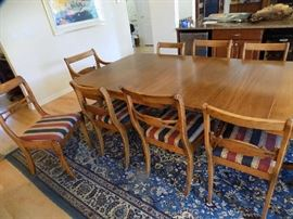 Table is 98 in. in length with 3 leaves. without is 62 in. long. 42 in. wide. 3 extra leaves 12 in. each .11 chairs. 1950's.  $450