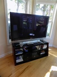 flat screen T.V with beautiful stand.