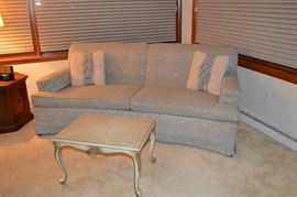 Vintage light blue sea shell patterned upholstery sofa.