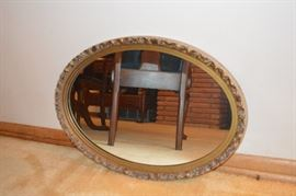Gold gilt oval mirror (one of 2 antique oval mirros.)