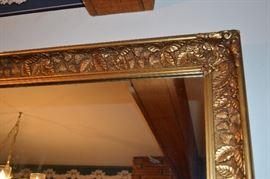 Strawberry design antique hold gilt mirror.