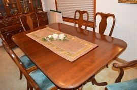 Stunning condition to this Ethan Allen rectangular table with two expansion leaves, 6 chairs, china cabinet, and tea cart!