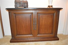 Slim hall cabinet with carved marble top