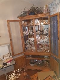 Oak China Cabinet built in work shop. Beautiful piece filled with Crystal and pink depression glass.