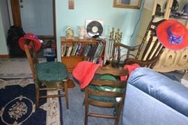 Cute little antique chairs and a book case