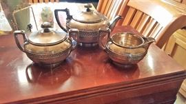 Tiffany tea set.  Love that warm old world luster.
