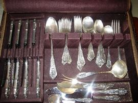Rose point Sterling flatware. Additional butter knives under the dinner knives