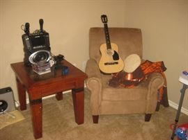 child's guitar, kareoke machine, upholstered chair and table