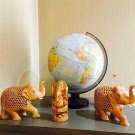Carved elephants, globe
