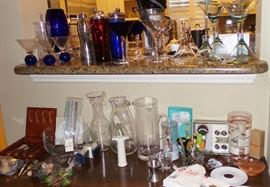 Entertaining items: vintage cocktail shakers, wine glasses, Waterford & Block Crystal wine & martini stems. Decanters, openers & gadgets for bar