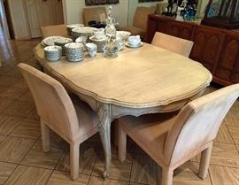 The Dining Room Table is in very good condition with 6 Upolstered Chairs