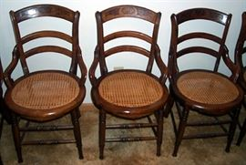 Three of six matching cane bottom chairs
