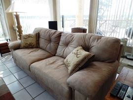 Leather couch with lots of character