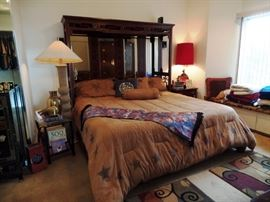 Asian inspired Master bed with great Texas bedding, unique but it works!