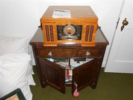 Little cabinet, records, CD's, tapes, tape recorder, Crosley EC, goose down pillows, more.