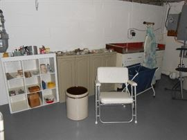 Miller pottery crock, boat chair, laundry sorter, ironing board, ironing chair, iron, more.