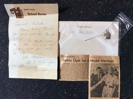 Handwritten letter from Burton's wife, Susan Hunt, on Burton's personal stationary, from 1976, along with an article, as well as a locket in the shape of Burton's personal logo that is printed on his stationary to Michelle. Along with 3 Christmas cards signed by Susan.