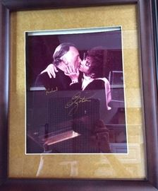 Framed Picture of Elizabeth Taylor and Richard Burton kissing, signed in gold, gifted by Brook Williams, godson of Richard Burton to Michelle, one of only 2 or 3 in existence.