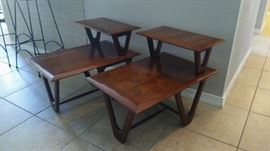 Two mid-century modern two-tier walnut side tables with hairpin leg configuration.