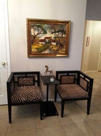 Two Asian inspired corner chairs with animal print.