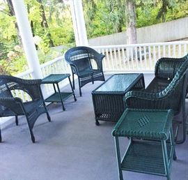 Sorry, the porch isn't included with this great wicker set.  But if you have one like it, the set will look just as good!