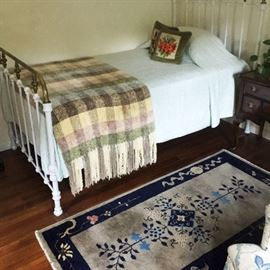 Wrought iron single bed - great for child's guest room , and antique Chinese area rug.