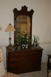 Eastlake mirror & dresser with marble top, Bavarian pitcher, silk plant, glass pitchers