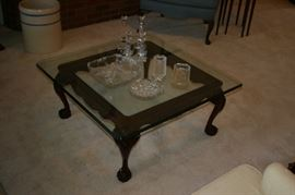 Carved Mahogany coffee table with glass top