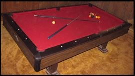 Slate top pool table in excellent condition also several cues and balls