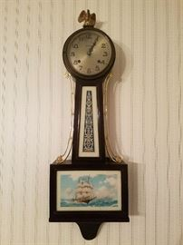 Antique clock with reverse painted glass of ship