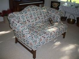 the matching love seat and old Christmas bells