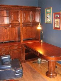 End section of the cherry Hooker bookshelf/cabinet with pedestal desk.