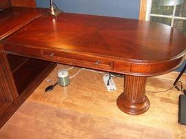Pedestal desk section of cherry Hooker home office.
