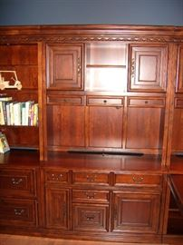 Middle section of cherry Hooker bookshelf/cabinet.