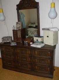 dresser, light bulb hanging lights, jewelry boxes