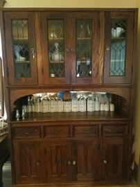 Leaded glass sideboard, antique canister and spice set