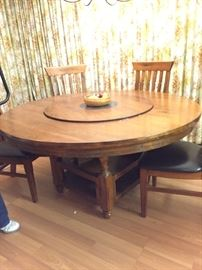 Round table unusual base and lazy Susan. 6 chairs