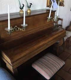 Piano with built-in candelabras for reading sheet music