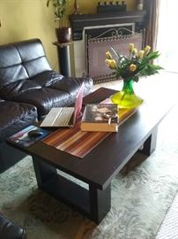 rosewood coffee table, area rug