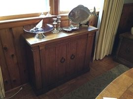 "Serving pieces, exceptional narrow (12"" deep) two door solid wood cabinet purchased at Willis Wayside in 1970"