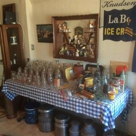 Collection of milk bottles and other dairy stuff. Vintage Knudsen ice cream tin sign
