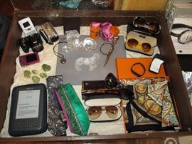 Hermes scarf, lalique tiger, waterford lion, digital cameras, channel sunglasses, jade frogs