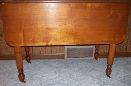 Antique drop leaf table with turned legs & casters