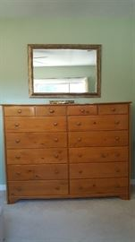 Bedroom set includes large dresser, lingerie chest, bedside table, and queen headboard.