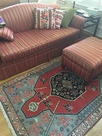 Nice apartment sized reupholstered sofa and ottoman.