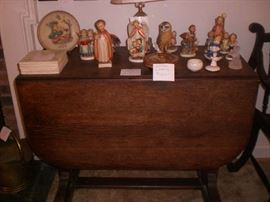 LARGE GROUP OF HUMMEL FIGURINES